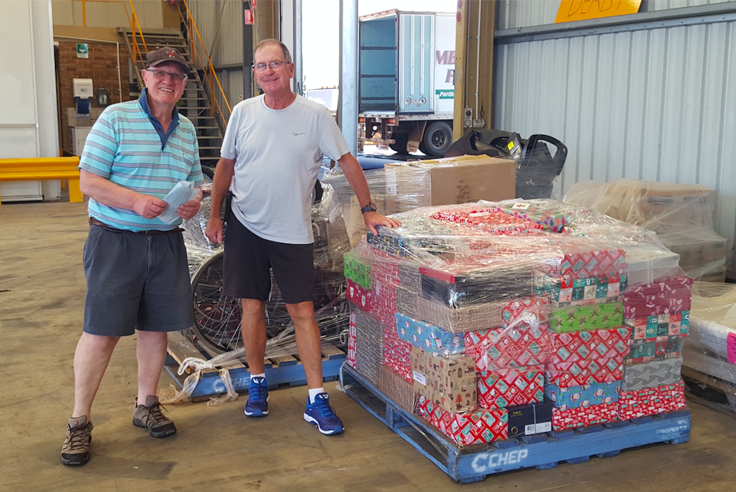 Richard and John with the pallet of presents